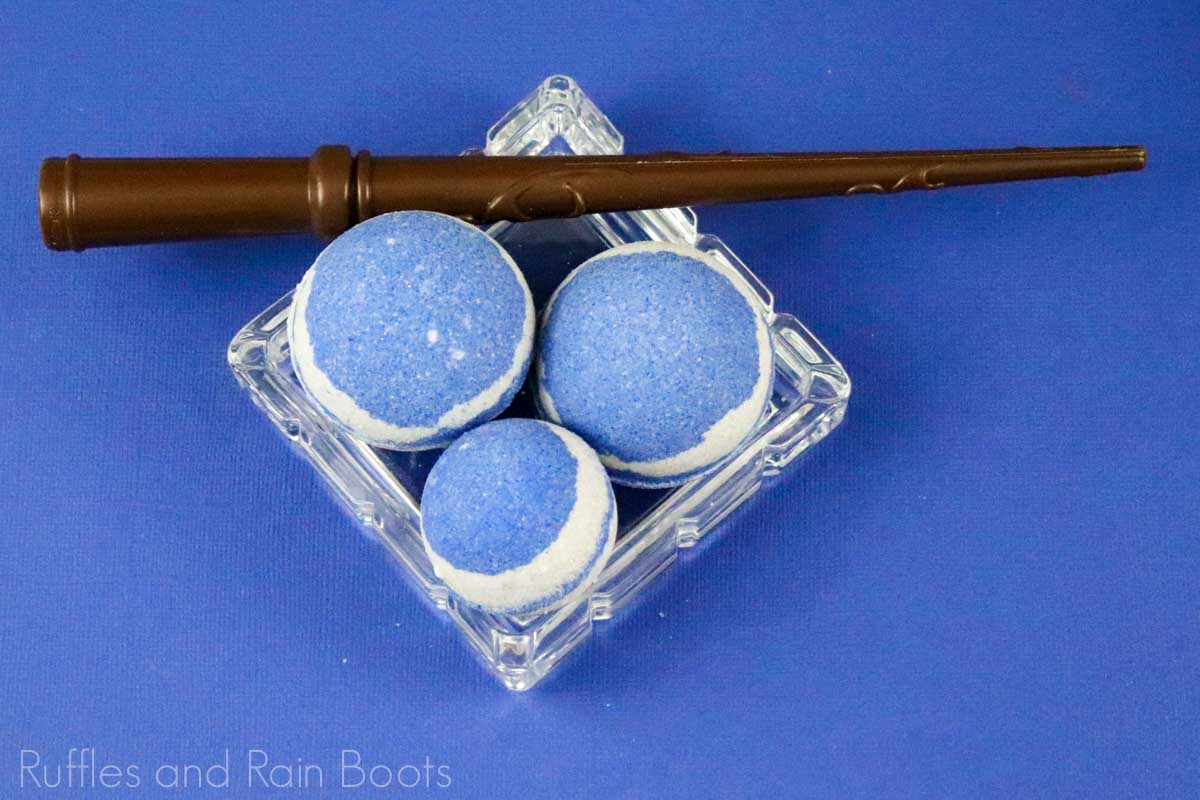 overhead view of ravenclaw harry potter bath bombs on a blue background