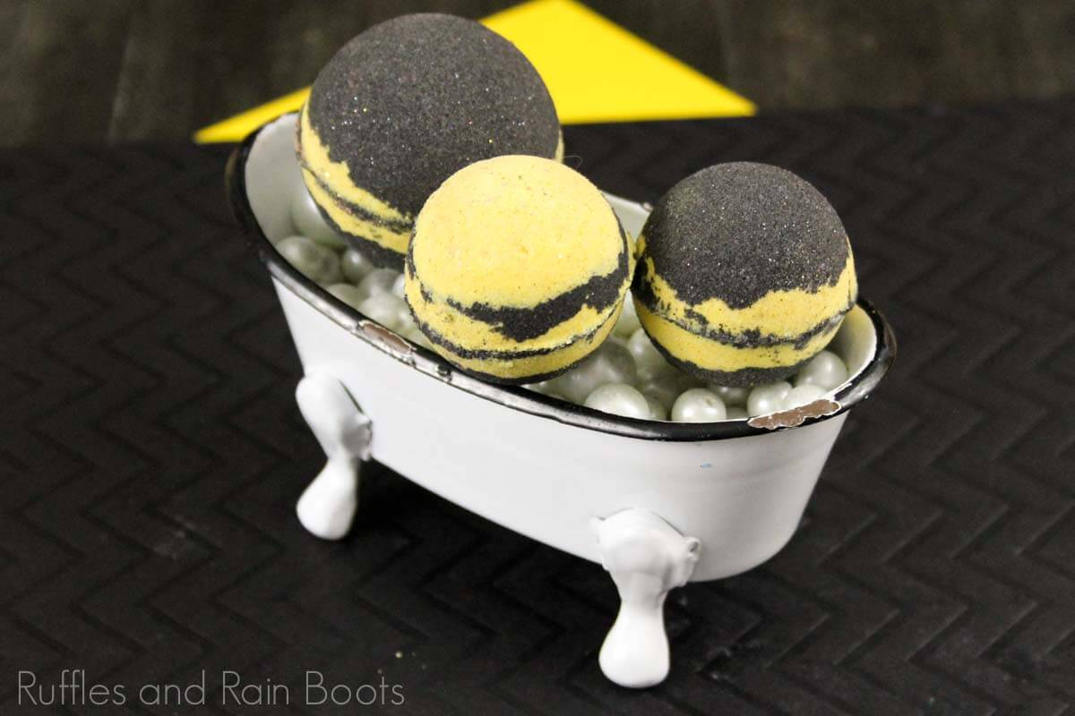 harry potter hufflepuff bath bomb recipe in a toy bathtub on a black and yellow background