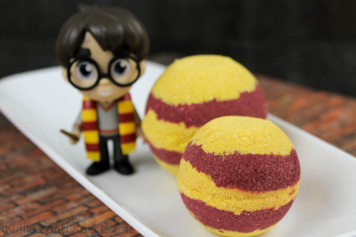 griffindor bath bombs for diy gift idea on a white plate with a harry potter figurine