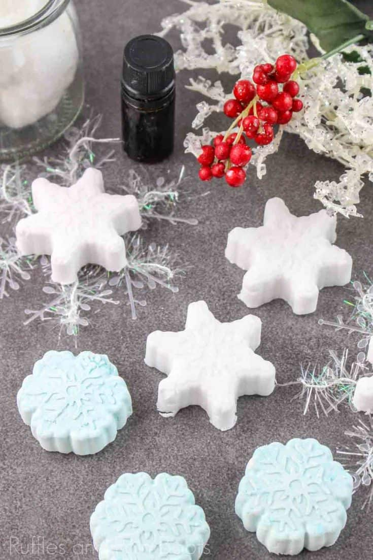 These snowflake shower fizzies are the cutest DIY gift idea! Click here to see how she makes this simple snowflake shower bomb in just a few steps! #snowflakeshowerbomb #snowflakeshowerfizzy #showerfizzies #howtomakeshowerfizzies #rufflesandrainboots