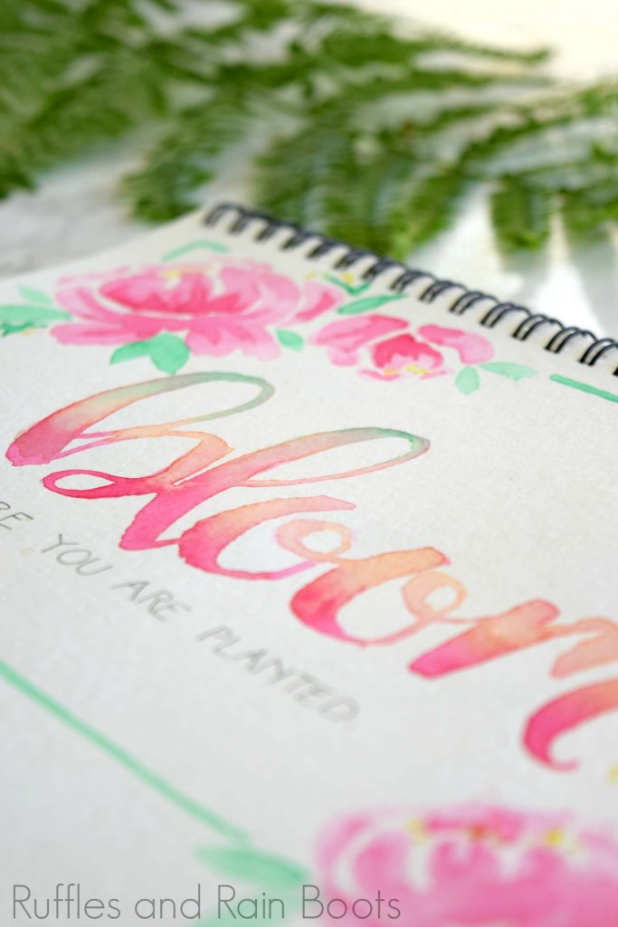 close up of watercolor art with brush calligraphy