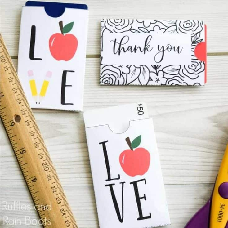 close up of teacher appreciation gift card sleeves on wood background