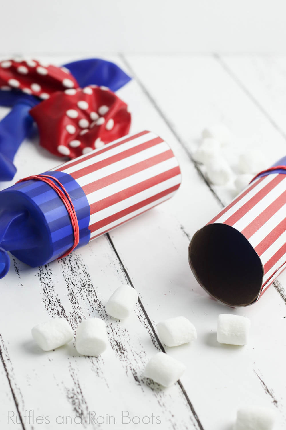 two marshmallow launchers on a wooden board as independence day party ideas for kids