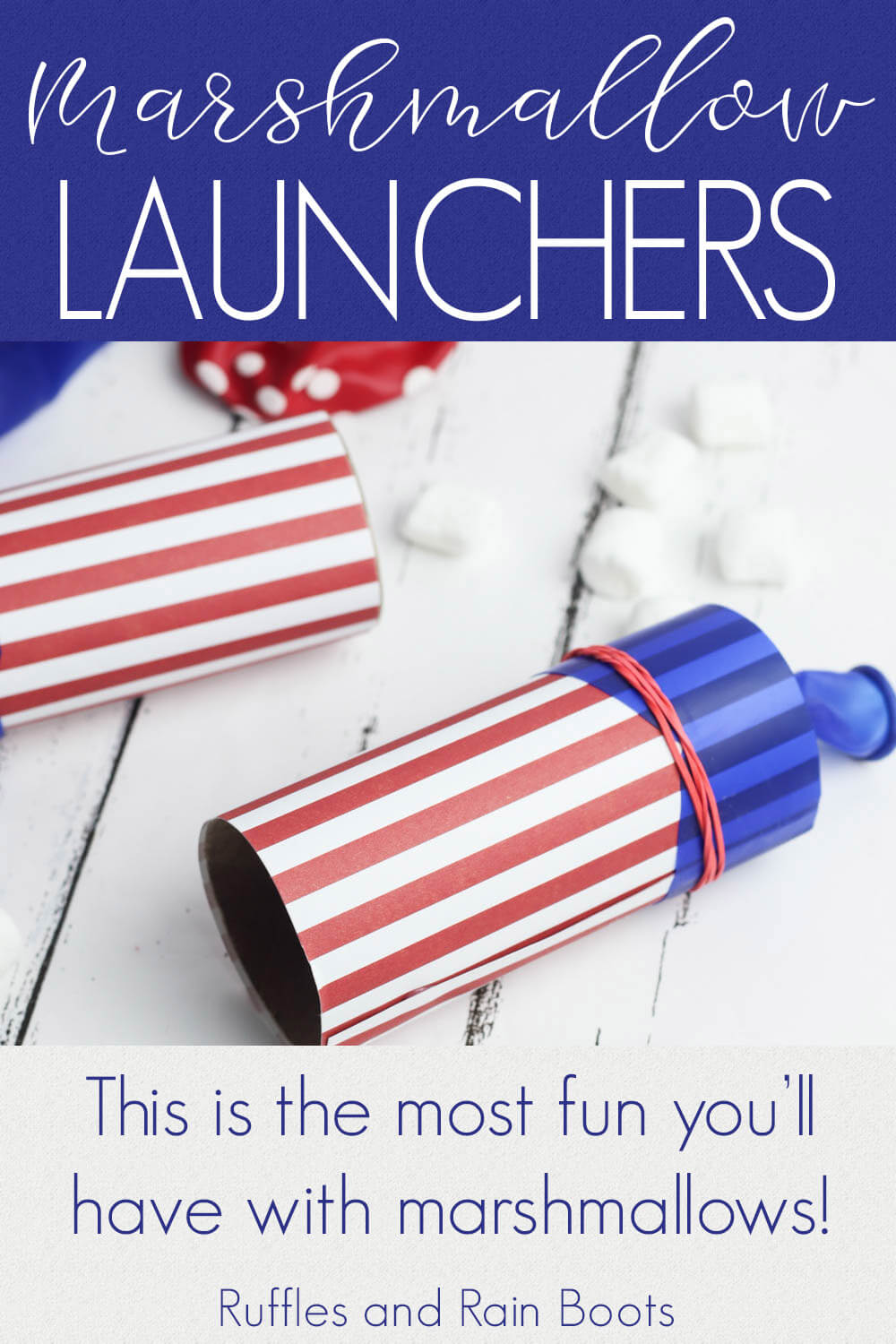 two marshmallow shooters launchers on a wooden board decorated for july 4th party with text which reads marshmallow launchers this is the most fun you'll have with marshmallows