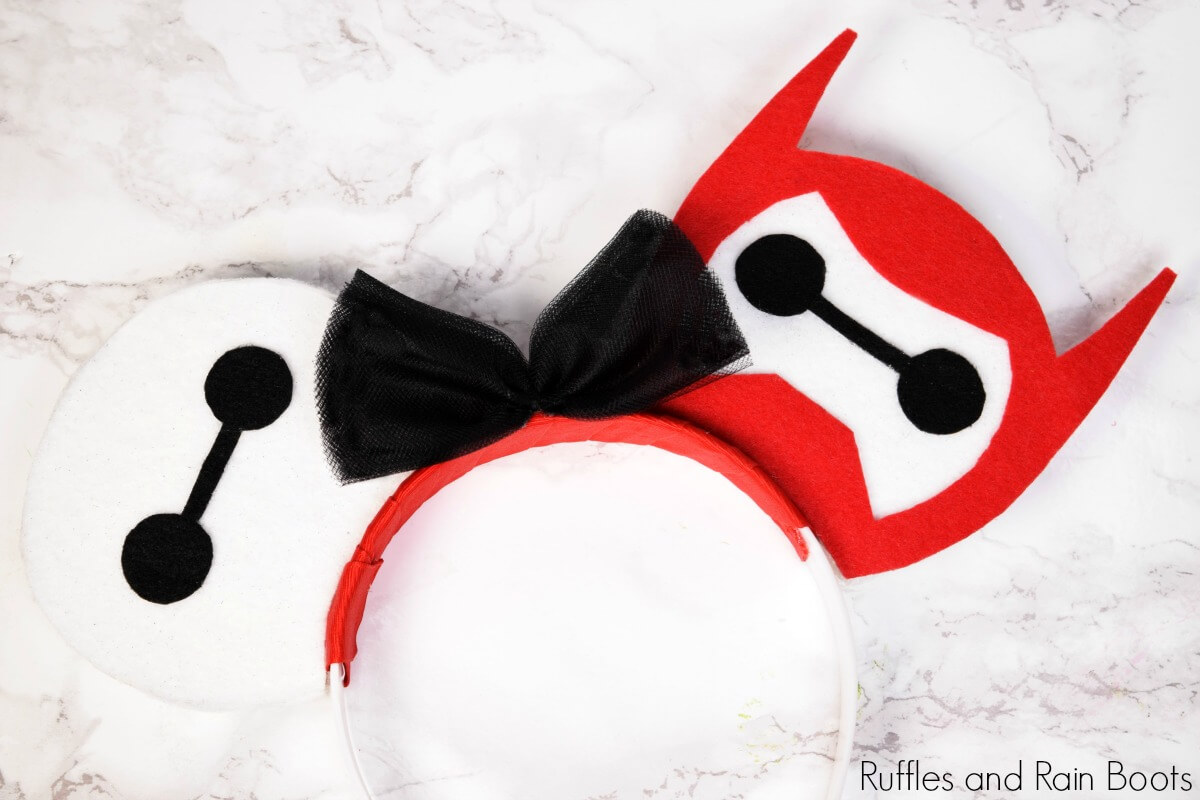 Close up of Baymax Mickey Mouse ears from Big Hero 6 on a white marble background