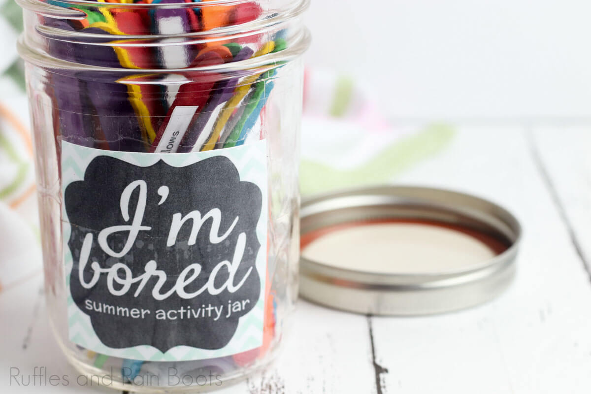 fun summer activity jar I'm bored jar for kids on a white wooden background