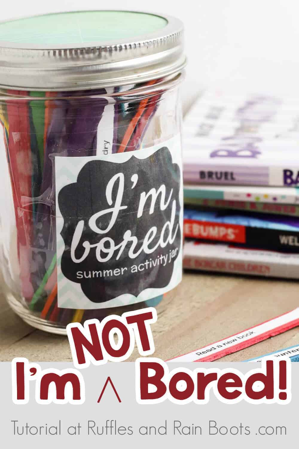 summer activity jar for kids on a wood table with magazines with text which reads I'm NOT Bored