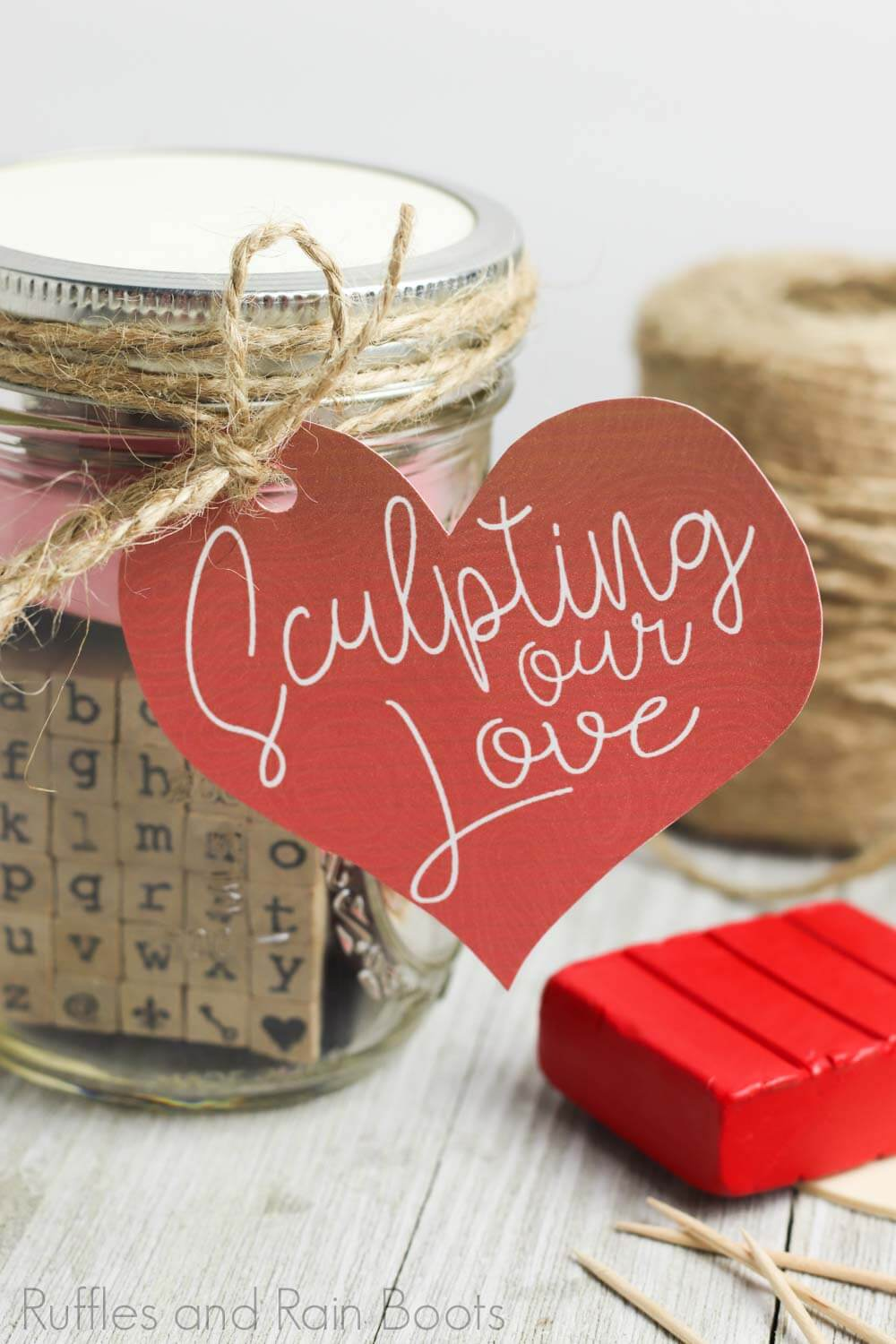 adorable date night idea sculpting night sculpting date night in a jar with red clay and twine on a wooden table with a white background
