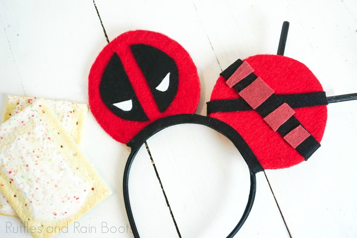 red and black Deadpool Mickey ears on white background with poptarts