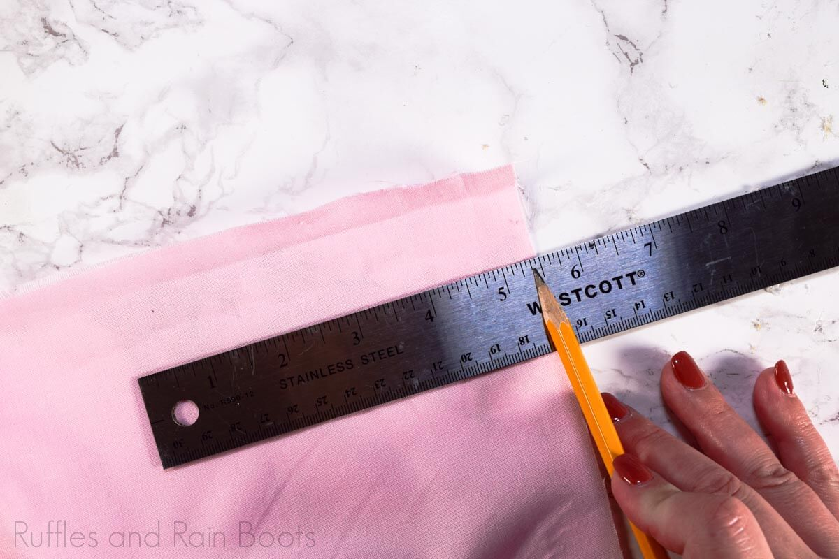 cut the Minnie bow fabric for a no sew Minnie Mouse bow