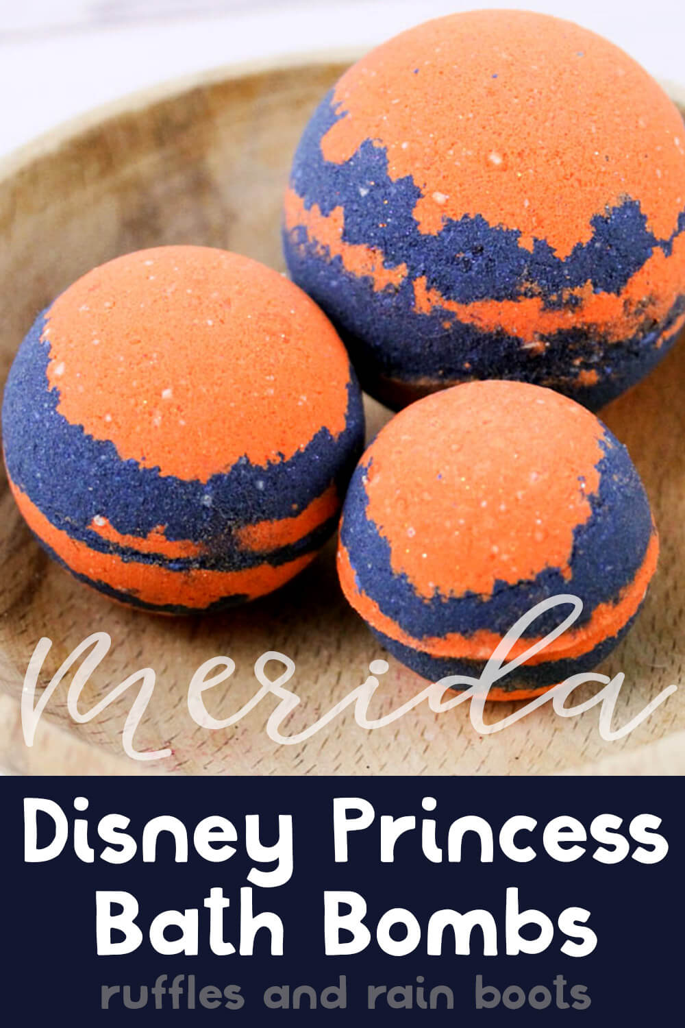 three bright orange and blue princess merida bath bombs on a wood table on a white background with text which reads merida disney princess bath bombs