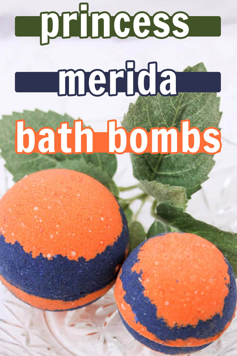 two orange and blue bath bombs on a white table with green leaves in the background with text which reads princess merida bath bombs