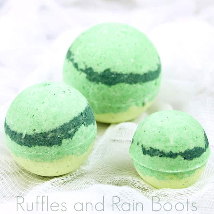 three pale green striped princess tiana bath bombs on a white table