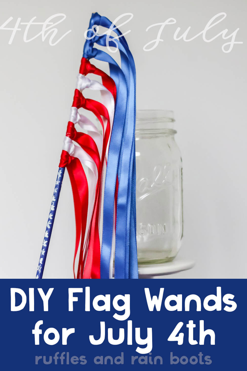 diy flag wands for independence day party leaning on a mason jar on a blue table in front of a white background with text which reads diy flag wands for july 4th