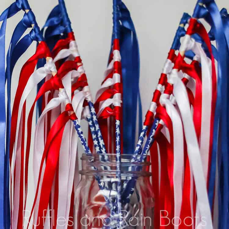 ribbon flag wands in a mason jar on a white background