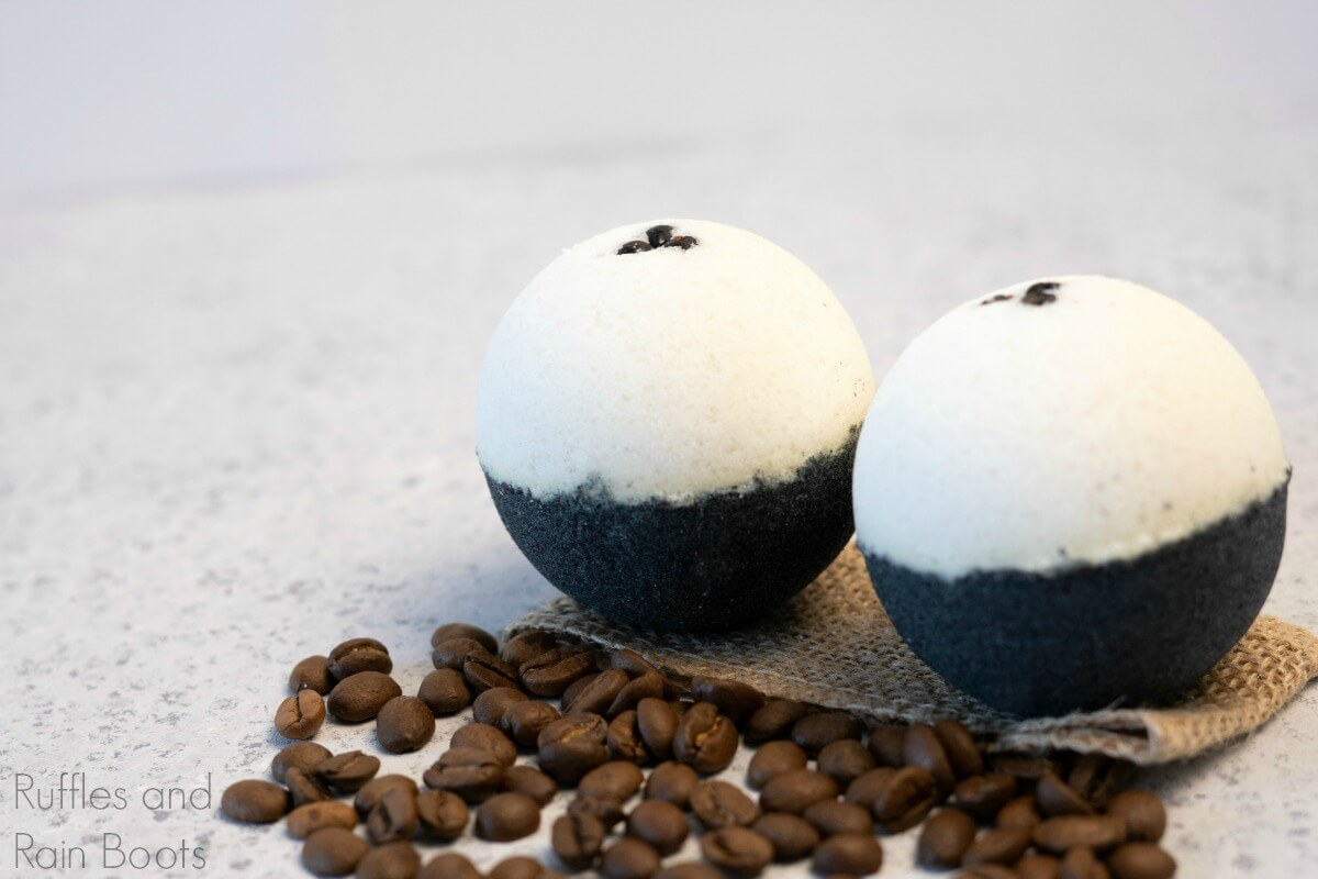 side view of coffee bath bombs and bath fizzies recipe on a brown linen with coffee beans on a grey table