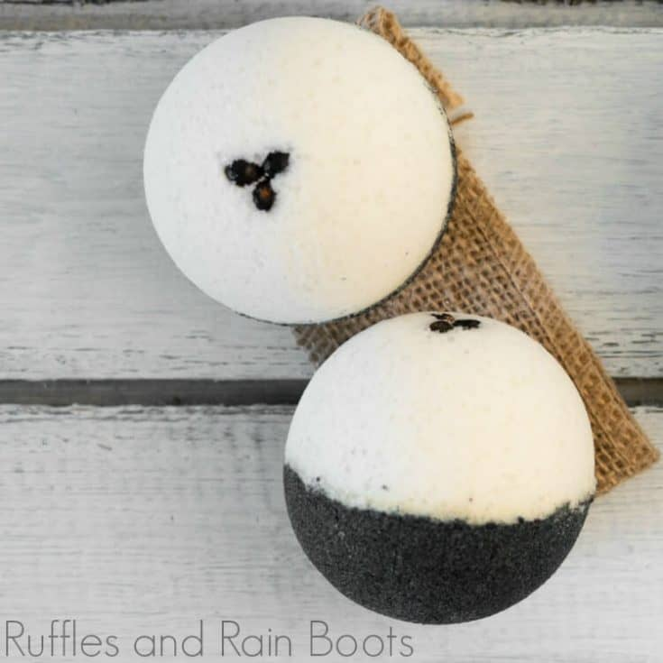 overhead view of two coffee bath bombs recipe on a brown linen on a grey wood table