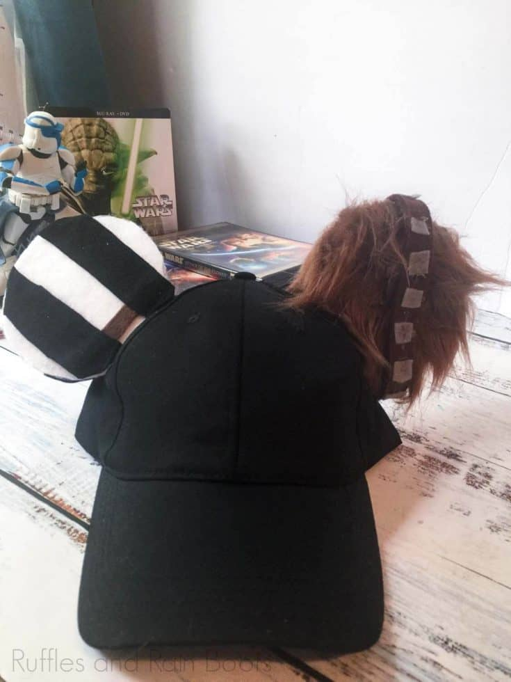 diy han solo and chewbacca mickey hat for disney on a white table with star wars memorabilia in the background