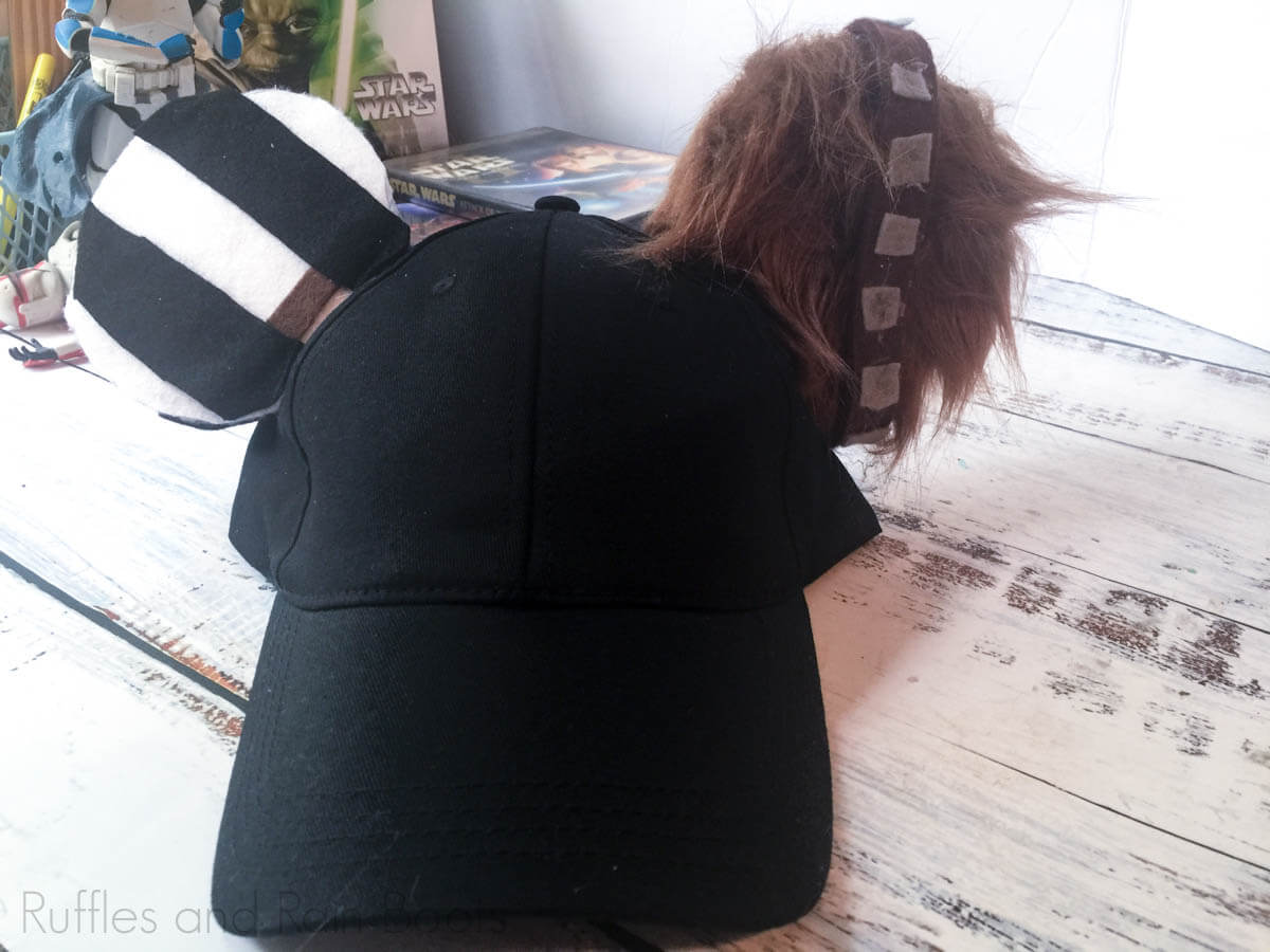 hand and chewbacca mickey ear hat on a white table