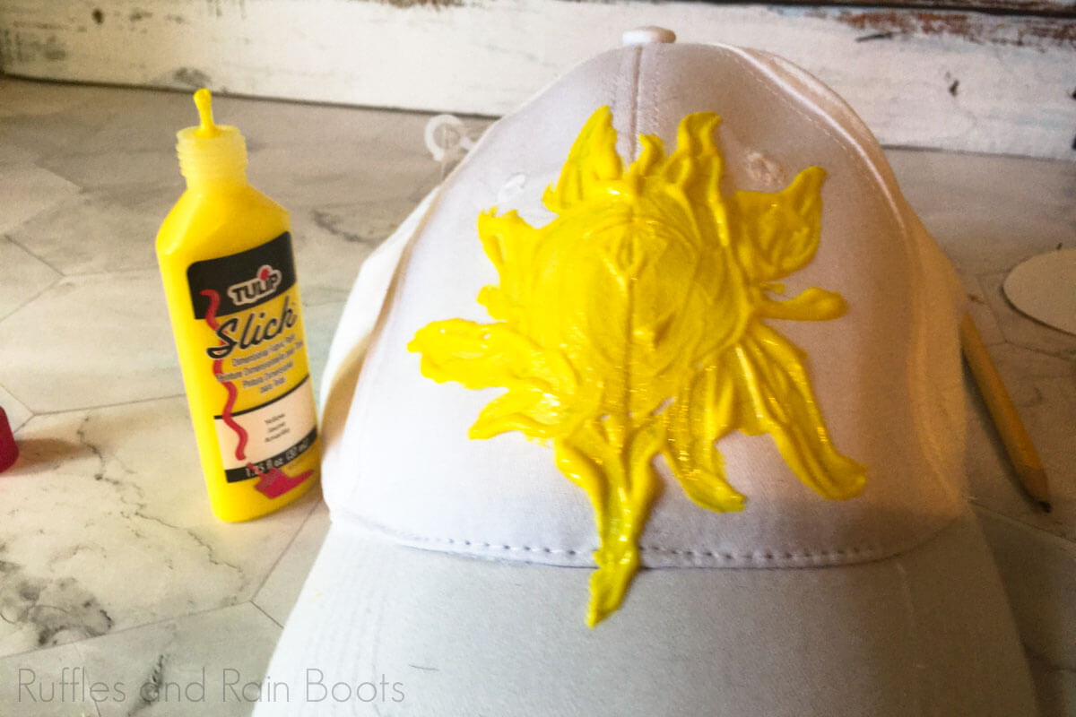 use fabric paint to paint sun on diy tangled mickey ear hat