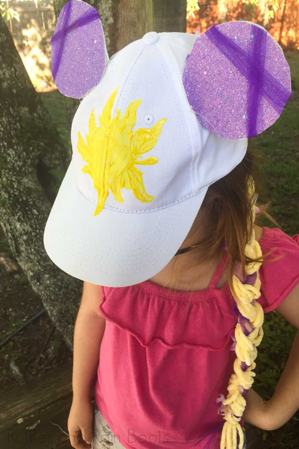 kid made rapunzel minnie ears on a child in a pink shirt