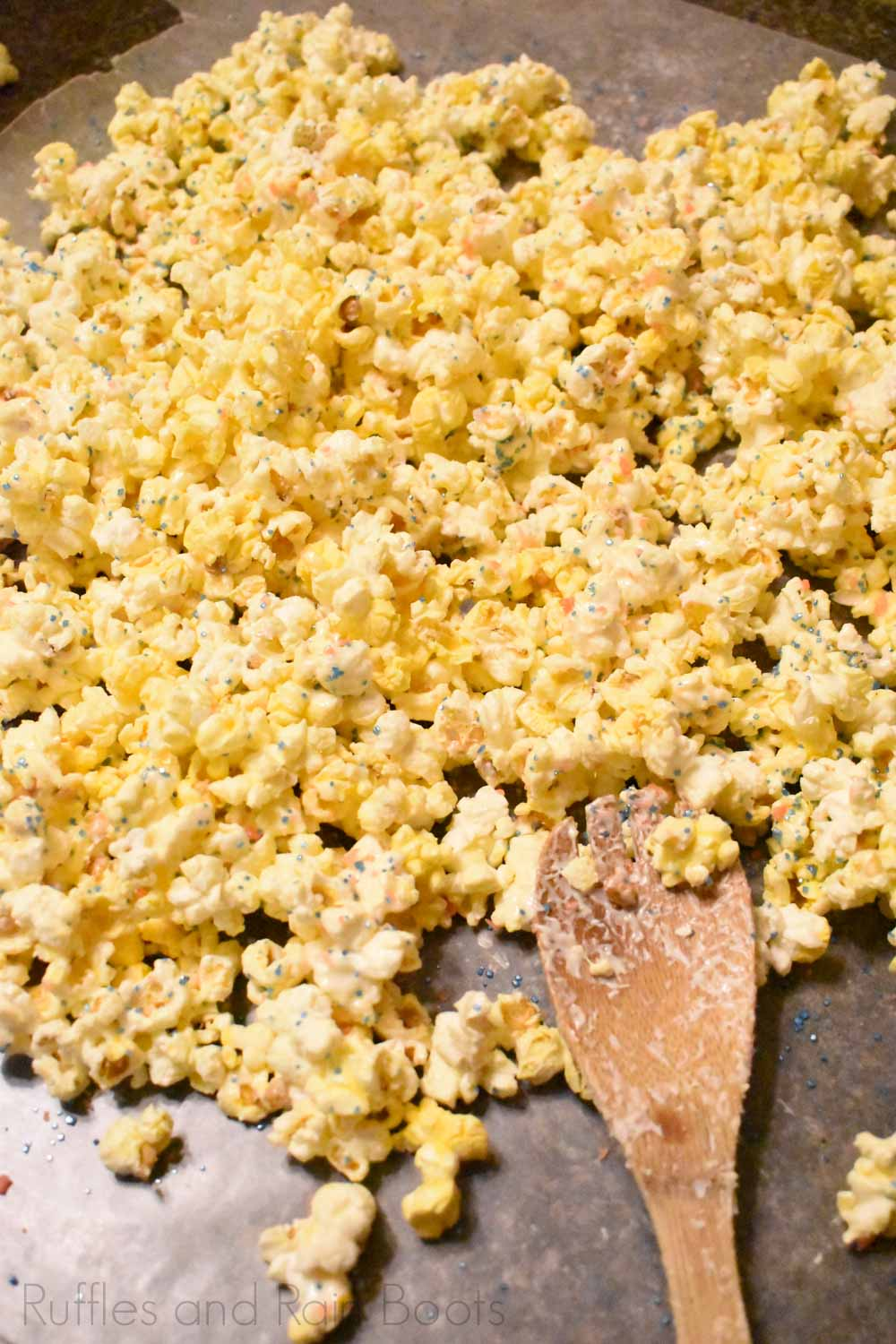 spread candy popcorn over wax paper