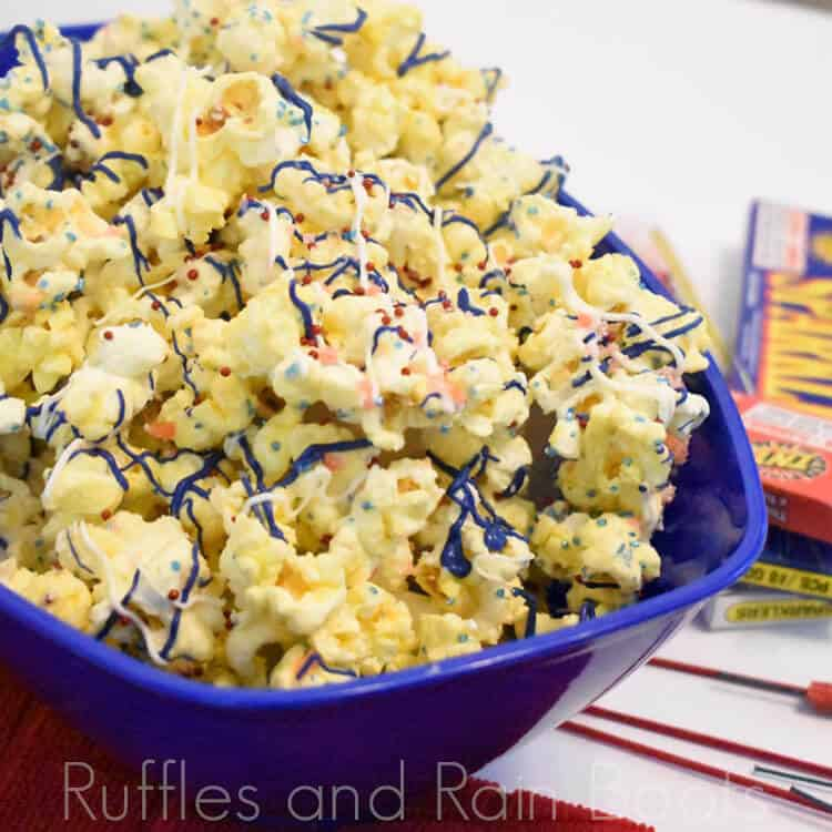 Red white and blue patriotic popcorn with pop rocks on white background with firecracker boxes