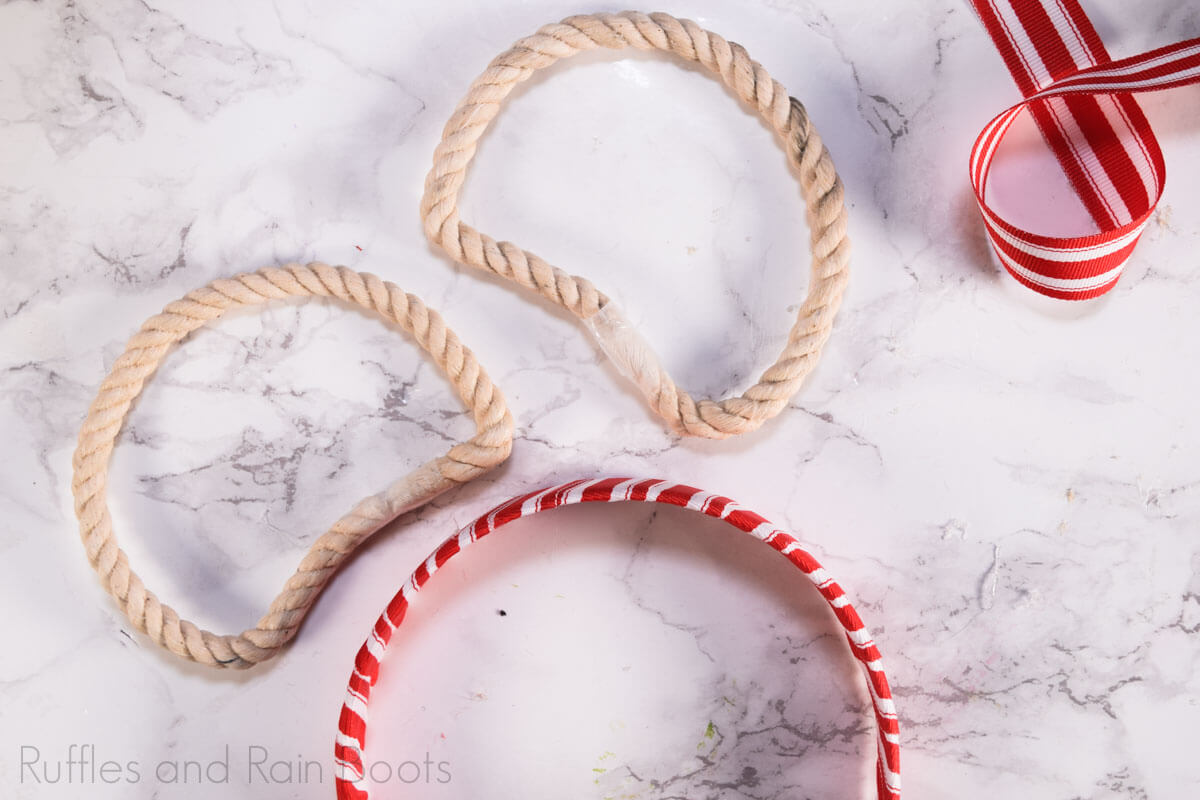 assemble the rope ears onto the wrapped headband and attach minnie mouse bow
