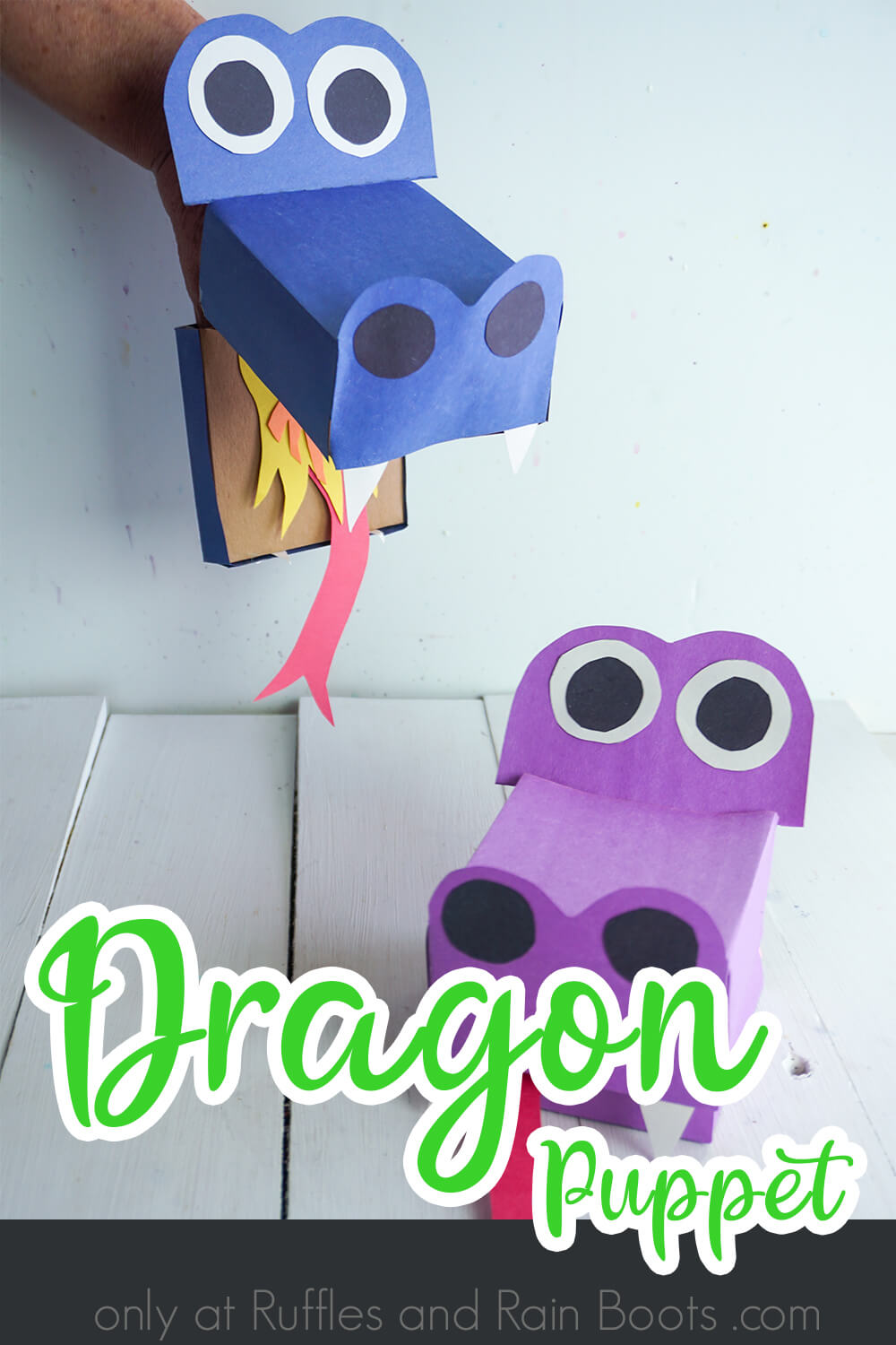 puppet craft for kids on a white wood background with text which reads dragon puppet