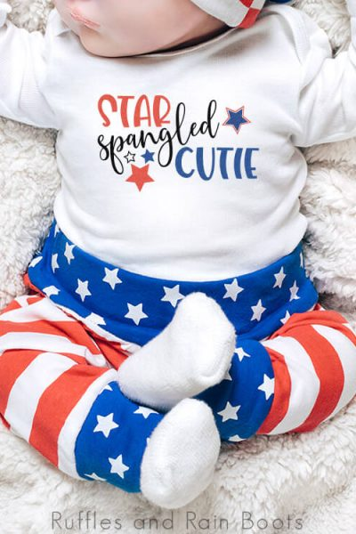 adorable baby on white blanket wearing red white and blue pants with onesie that has a star spangled cutie patriotic svg on it