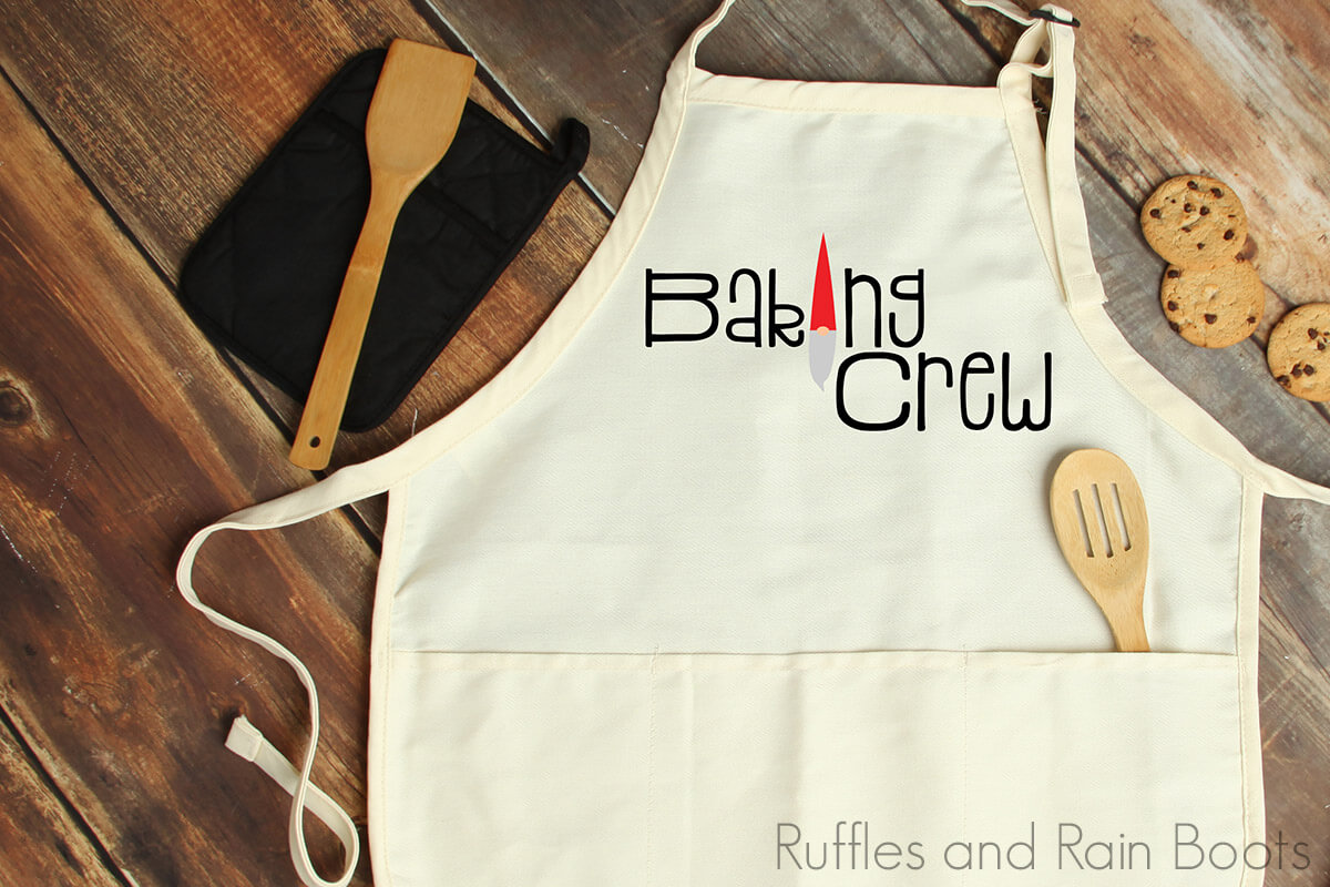 free baking crew svg with adorable gnome cut in vinyl and placed onto an apron for holiday baking