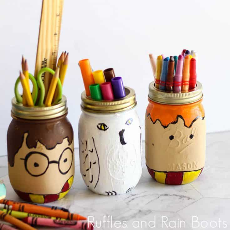 Harry Potter jars painting craft for kids filled with school supplies on a white background