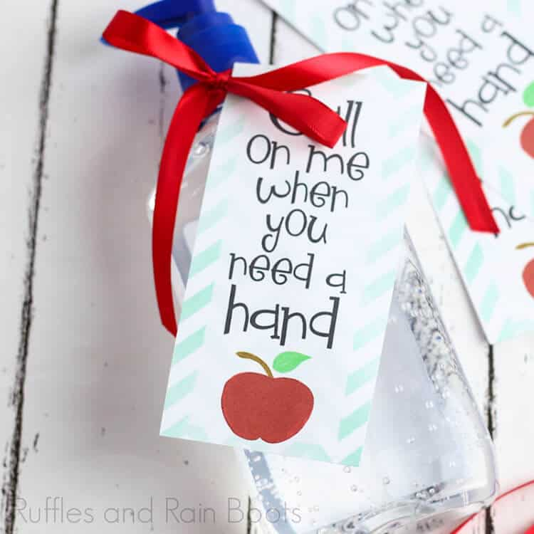 Hand Sanitizer Printable Tag laying on a white wood table