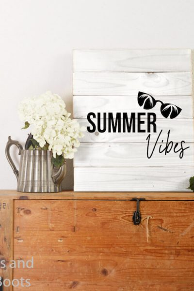 free svg for summer fun Summer Vibes with Palm Tree Sunglasses on Wood Sign on a trunk against a white wall with flowers beside it
