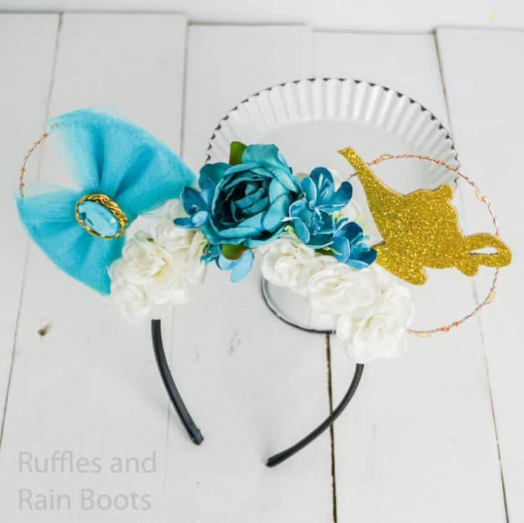 easy floral mickey ears princess jasmine on a white background leaning on a cupcake plate