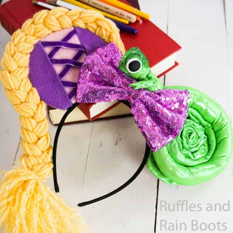 diy rapunzel mickey ears for disney on a white wood background with books and paint brushes