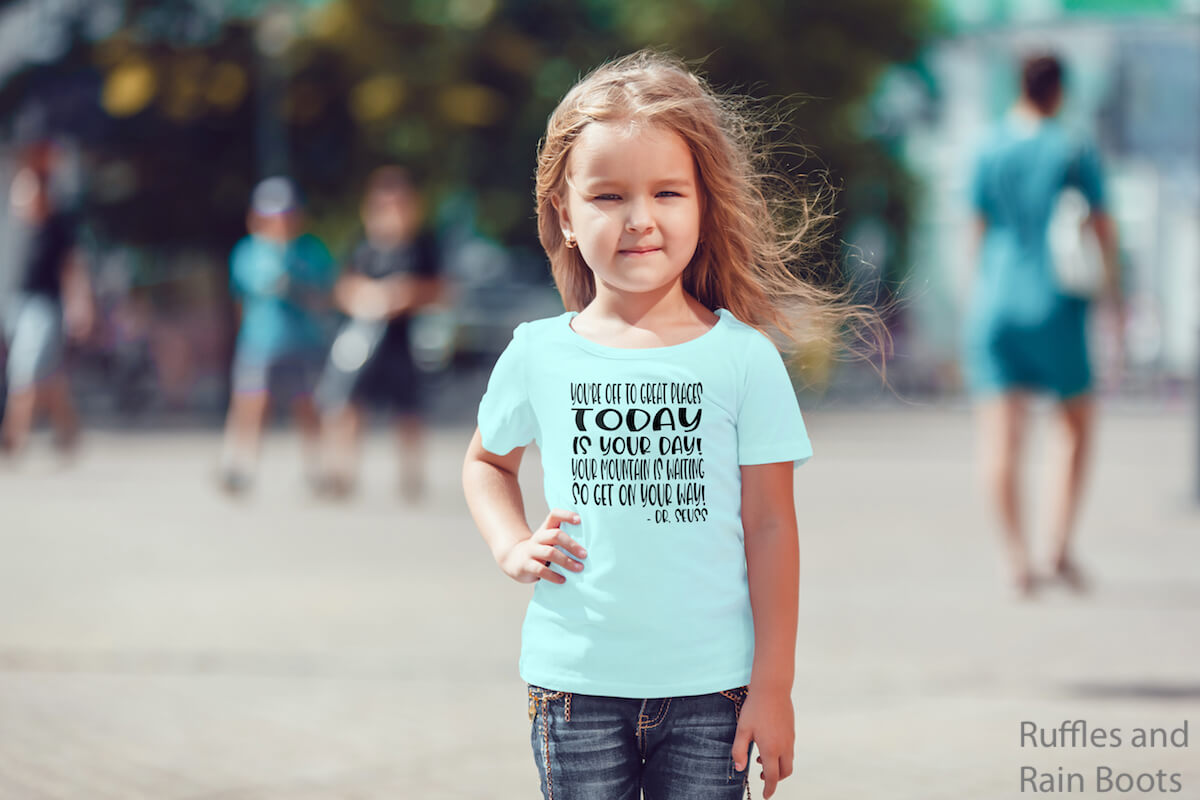 Dr. Seuss Quote back to school svg on Kid TShirt worn by a little girl on a street with people in the background