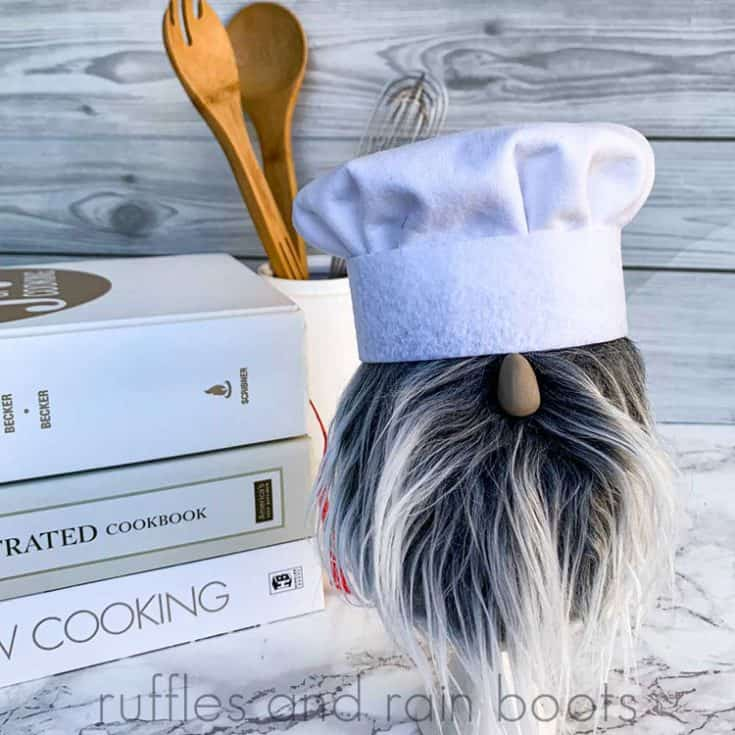 close up of chef gnome in front of cookbooks and kitchen utensils