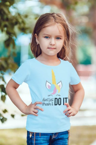 Don't Just Dream It Do It unicorn cut file for silhouette on kids shirt worn by a little girl standing on a street