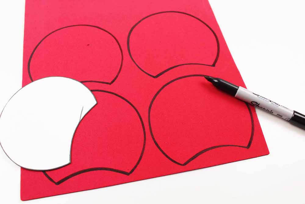 how to make evil queen poison apple minnie ears by tracing the ear shape onto the red material