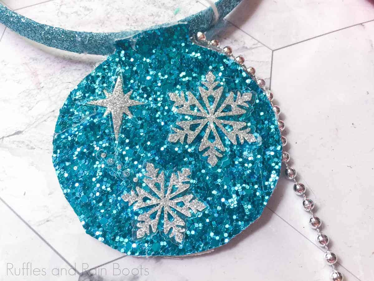 how to make anna and elsa minnie ears Step 5 add snowflake stickers