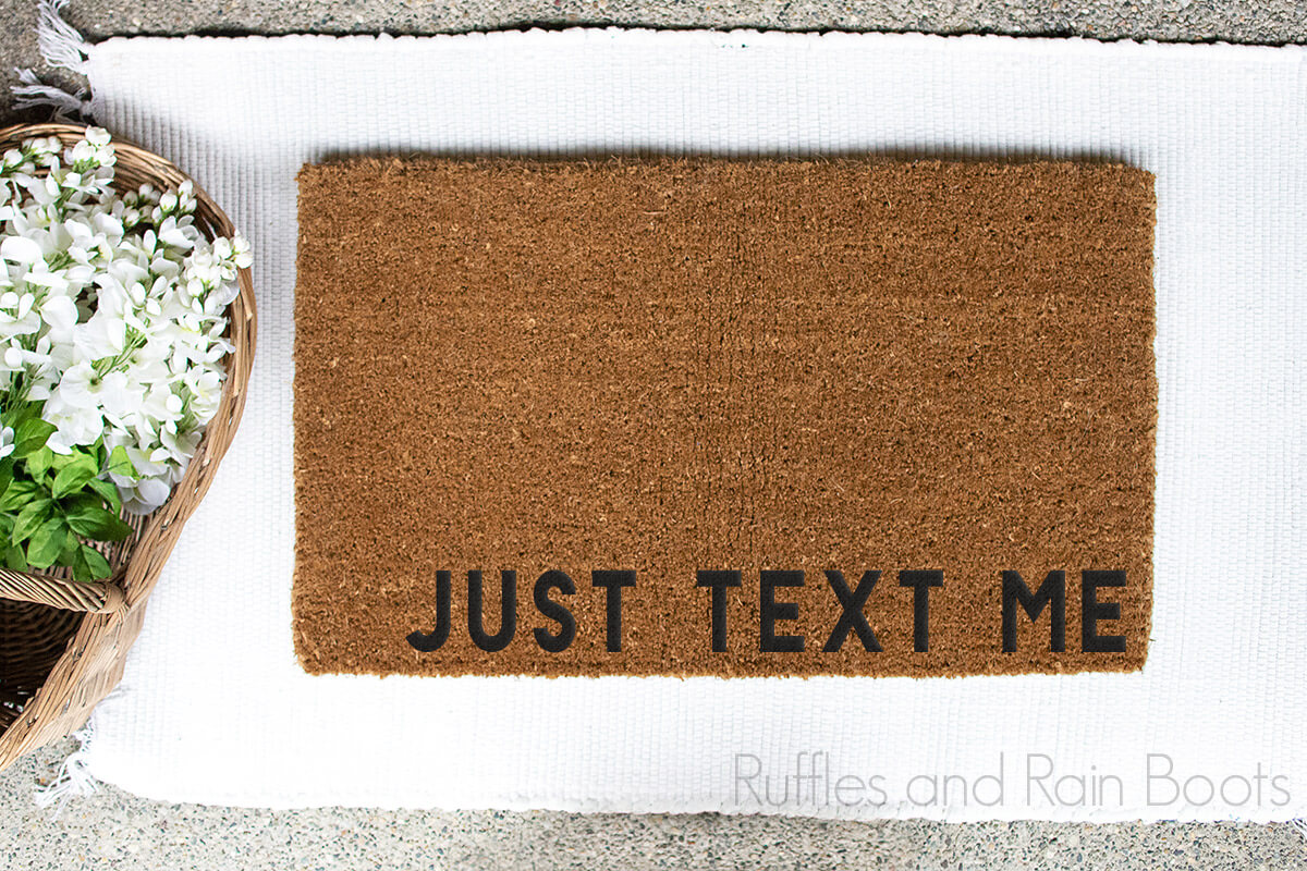 Just Text Me Doormat SVG for Cricut on a white background