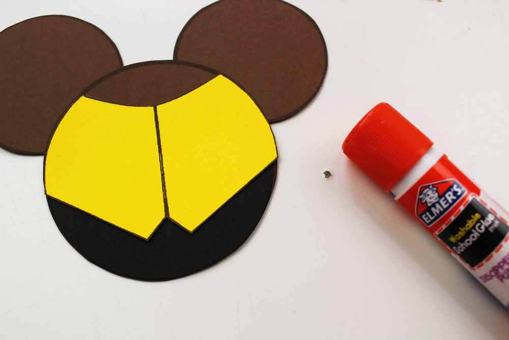 how to make beauty and the beast christmas ornaments glueing the pieces of belle's dress on the mickey ears