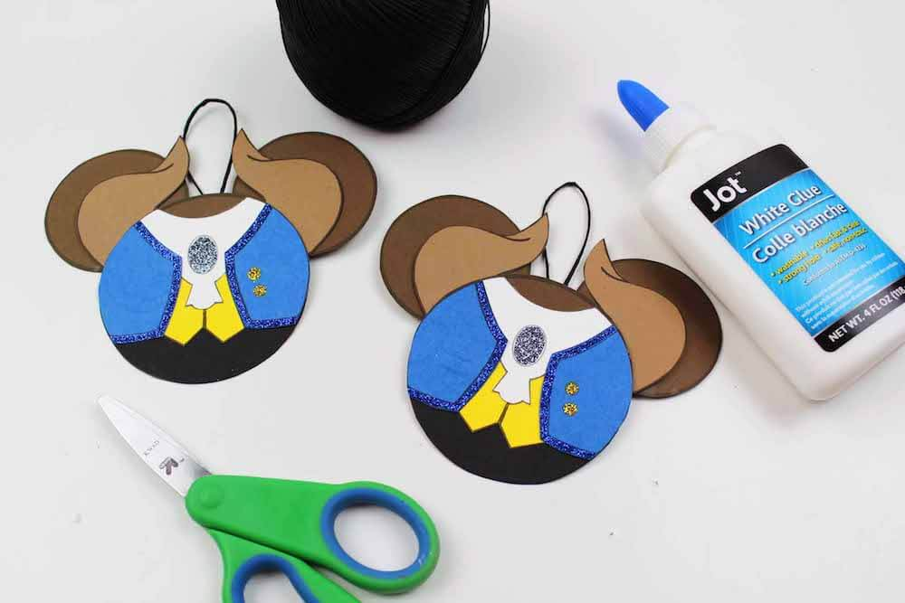 how to make easy christmas ornaments inspired by beauty and the beast final step for beast ornaments