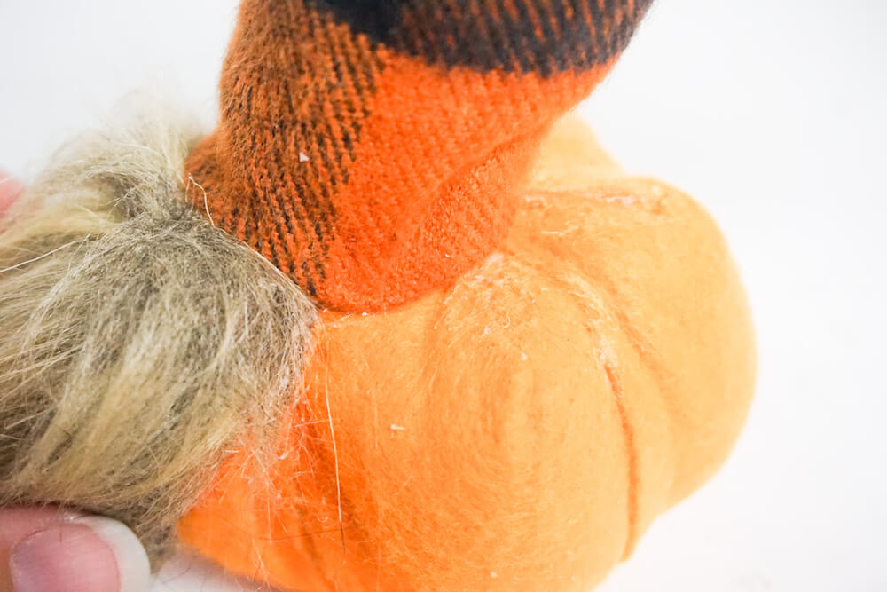 how to make a fall pumpkin gnome adding the hat, beard and nose to the pumpkin