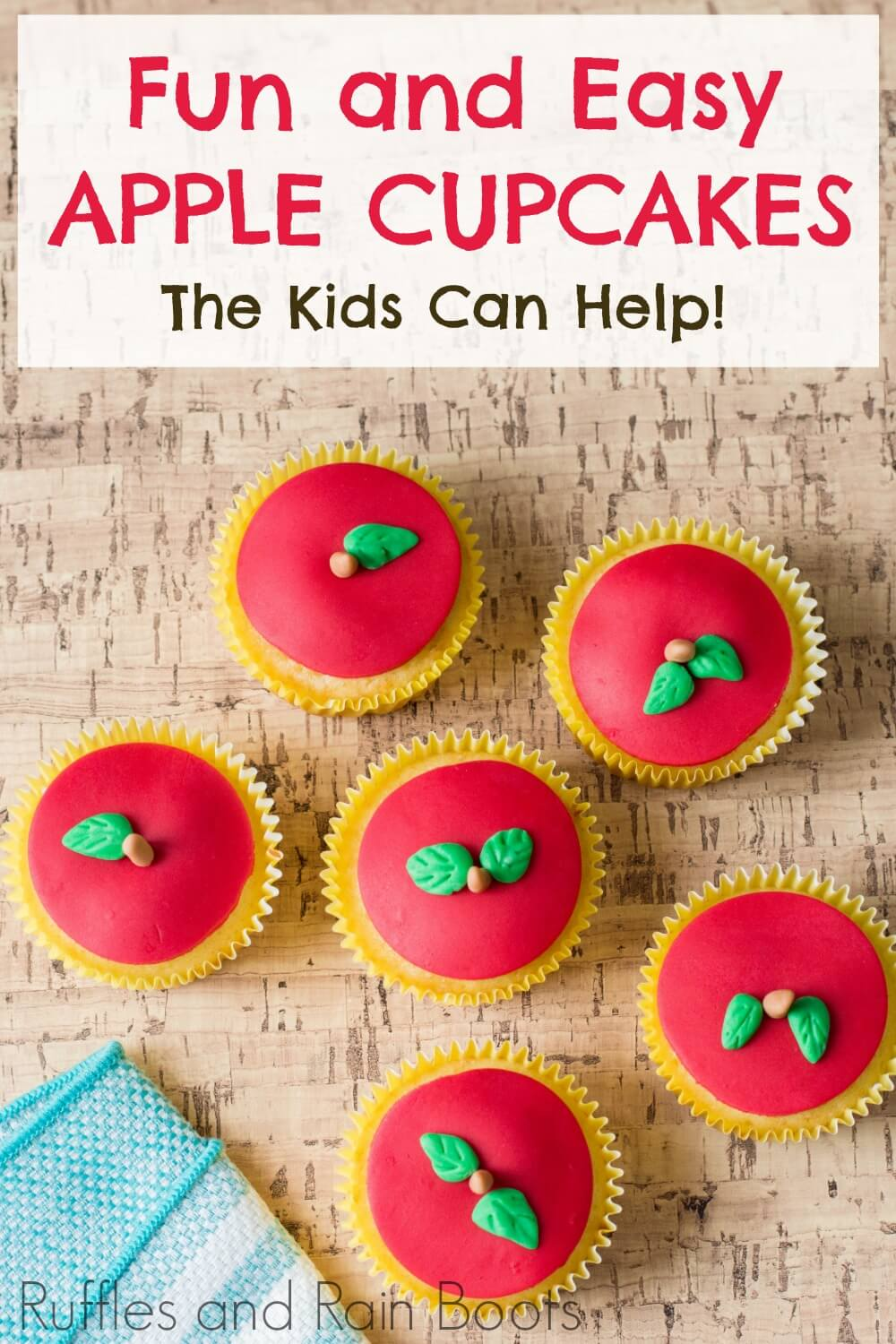lots of apple shaped cupcakes made with fondant on a brown table with text which reads Fun and Easy Apple Cupcakes the kids can help!