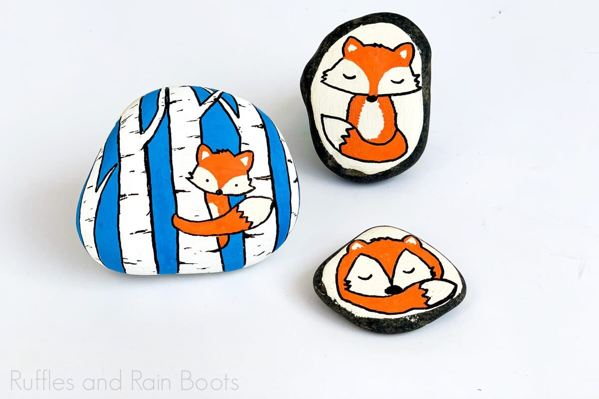 three fox rock painting ideas on white background