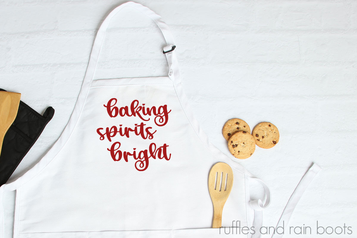 white apron with red baking spirits bright svg with a fun flourish design made as Christmas gift idea with Cricut