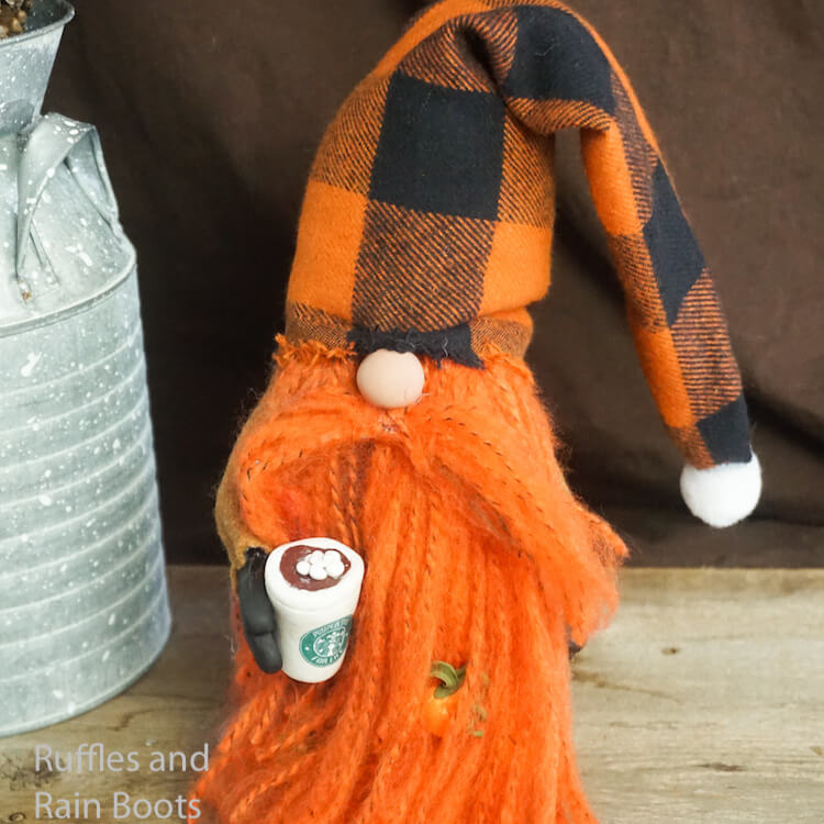 how to make a pumpkin spice gnome with a starbucks cup on a brown wood background