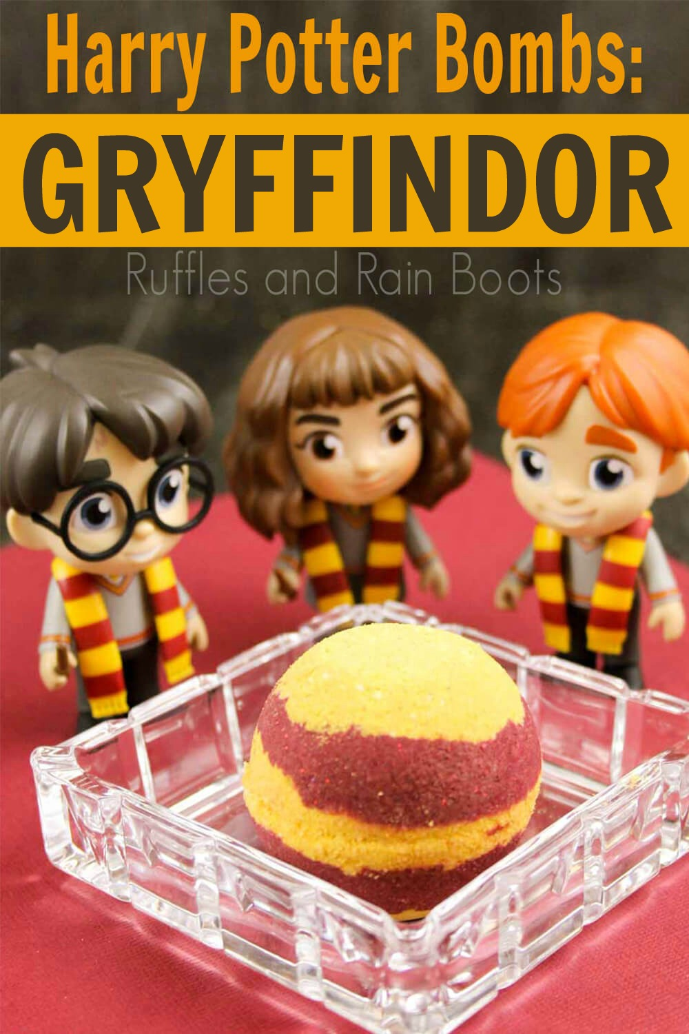 red and yellow striped Gryffindor harry potter bath bombs in glass dish with tiny harry potter figurines on red background